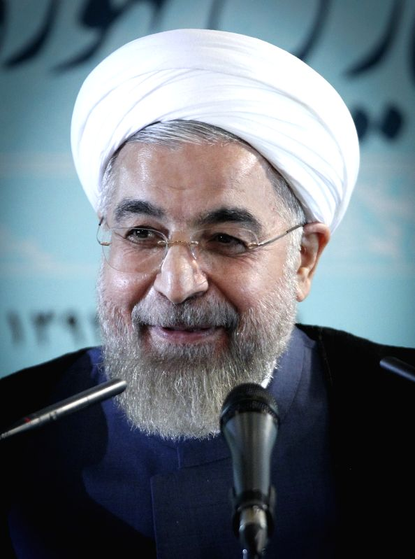 Iranian President Hassan Rouhani speaks during a news conference in Tehran, Iran, Aug. 30, 2014. Iranian President Hassan Rouhani said Saturday although recent U.S. ..