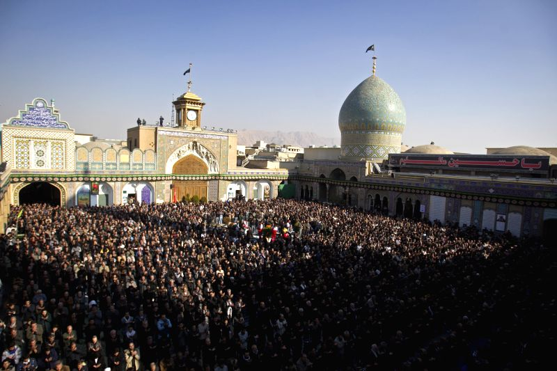 Shiite Muslims attend a procession as they observe Arbaeen festival in Shahre-e Rey, south of Tehran, Iran, on Dec. 13, 2014. Arbaeen is a Shiite Muslim religious ...