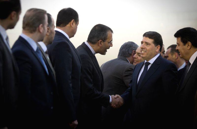 Syrian Prime Minister Wael al-Halqi (2nd R, front) arrives at Mehrabad Airport in Tehran, Iran, on Dec. 15, 2014. Syrian Prime Minister Wael al-Halqi arrived in ... - Wael
