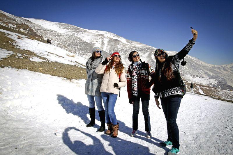 Iranian women take a selfie at the Tochal ski resort in northern Tehran, capital of Iran, on Dec. 26, 2014. Iranians flock to ski resorts around Tehran for winter ...