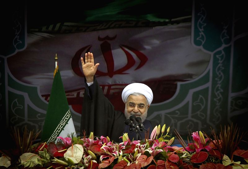 Iran's President Hassan Rouhani waves during a rally to mark the 36th anniversary of the Islamic revolution at Azadi (liberty) Square in Tehran, Iran, on Feb. 11, ... - Hassan Rouhani
