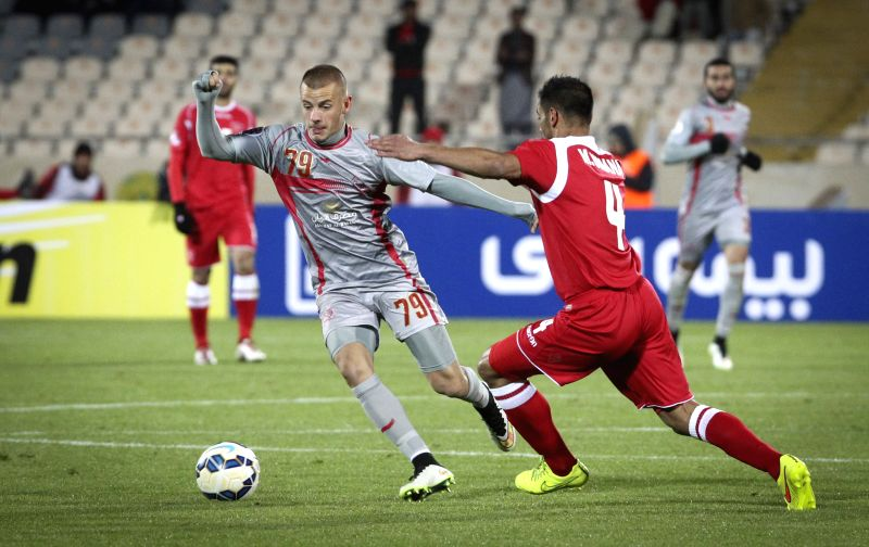 Vladimir Weiss (L) of Qatar's Lekhwiya vies with Michael Umana of Iran's Persepolis during the Asian Champions League Group A football match at Azadi Stadium in ...