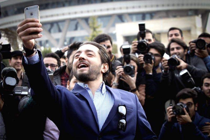 "Iranian actor Bahram Radan takes selfie during the photocall for the film ""Ice Age"" at the 33rd Fadjr International Film Festival in Tehran, Iran, on Feb. .. - Bahram Radan"
