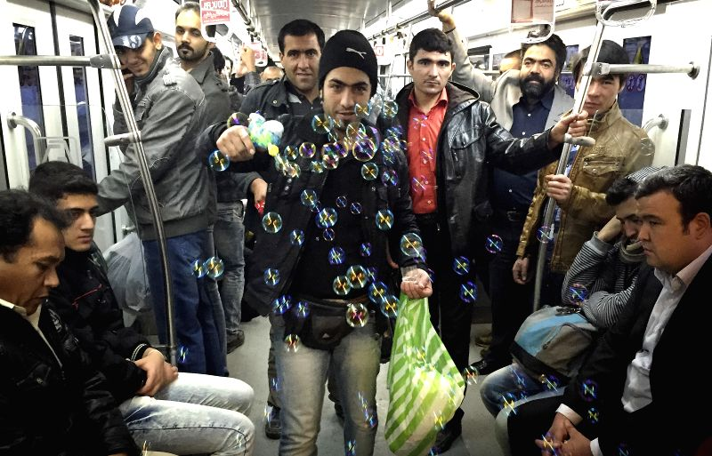 Tehran (Iran):  A vendor makes bubbles at subway Line 1 in Tehran, capital of Iran, on Nov. 28, 2014. The Tehran's subway carries more than 2 million passengers a day.