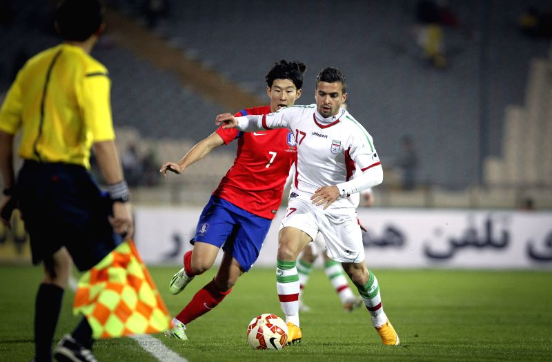 Tehran (Iran): Iran's Soroush Rafiei (R) vies with South Korea's Son Heung Mim during their soccer friendly match at Azadi stadium in Tehran, Iran, Nov. 18, 2014. Iran won 1-0. (Xinhua/Ahmad ...