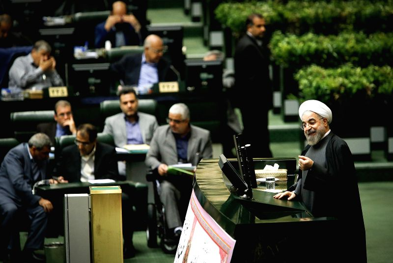 Tehran (Iran): Iranian President Hassan Rouhani (R) addresses a Majlis (parliament) session in Tehran Nov. 26, 2014. Iran's Majlis on Wednesday approved Hassan Rouhani's nomination of Mohammad ...