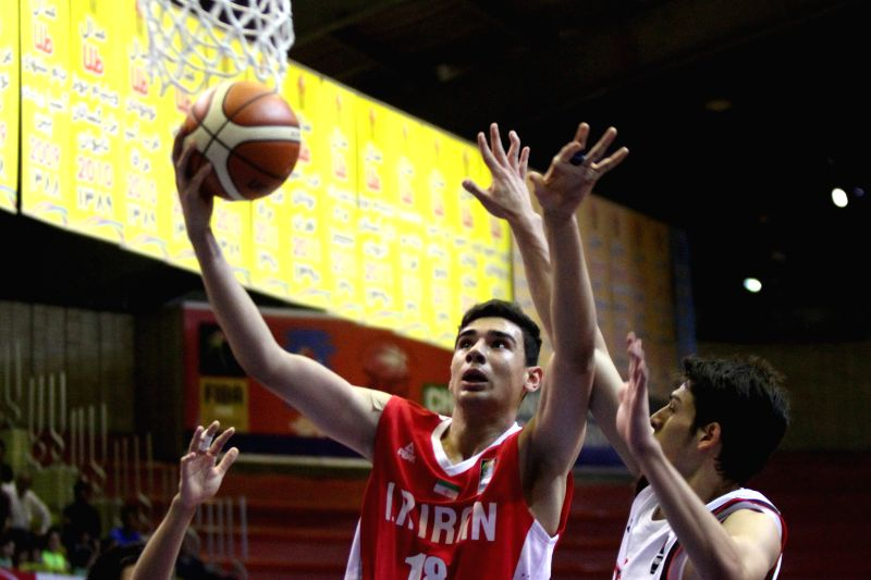 TEHRAN, July 25, 2016 - Amirhossein Khandanpoor (L) of Iran drives to the basket during the match between Iran and Japan at the 24th FIBA Asia U18 Championship in Tehran, Iran, on July 24, 2016. ...