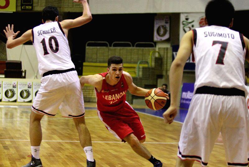 TEHRAN, July 26, 2016 - Salim Alaeddine (C) of Lebanon drives the ball during a match between Lebanon and Japan at 24th FIBA Asia U18 Championship in Tehran, Iran, on July 26, 2016. Japan lost the ...