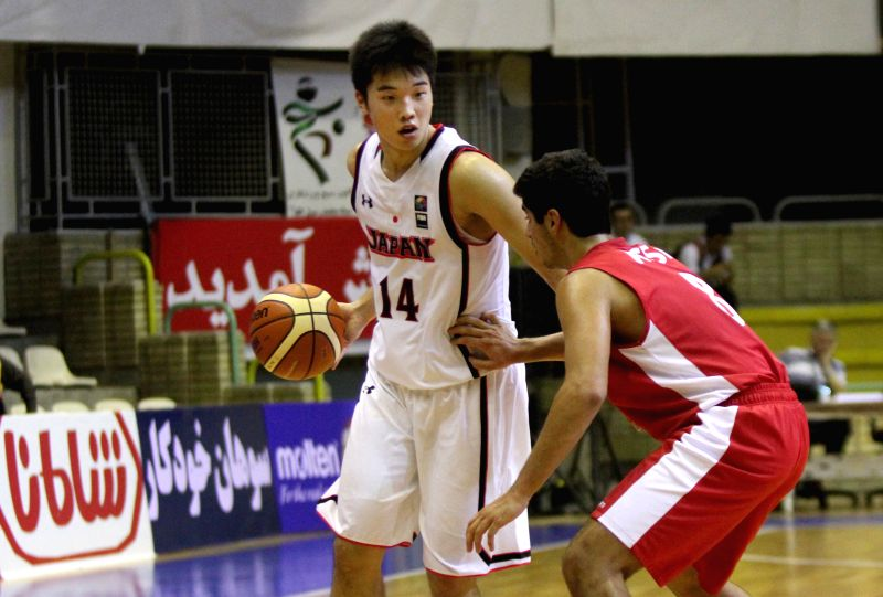 TEHRAN, July 26, 2016 - Yudai Nishida (L) of Japan vies with Karl Assl of Lebanon during a match between Lebanon and Japan at 24th FIBA Asia U18 Championship in Tehran, Iran, on July 26, 2016. Japan ...