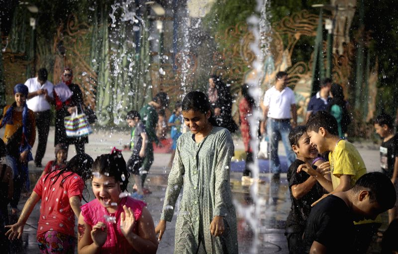 Iranian children play with water at a park in Tehran, Iran, on July 30, 2014. A heatwave with the temperature of over 40 degrees Celsius swept the city in the past ..
