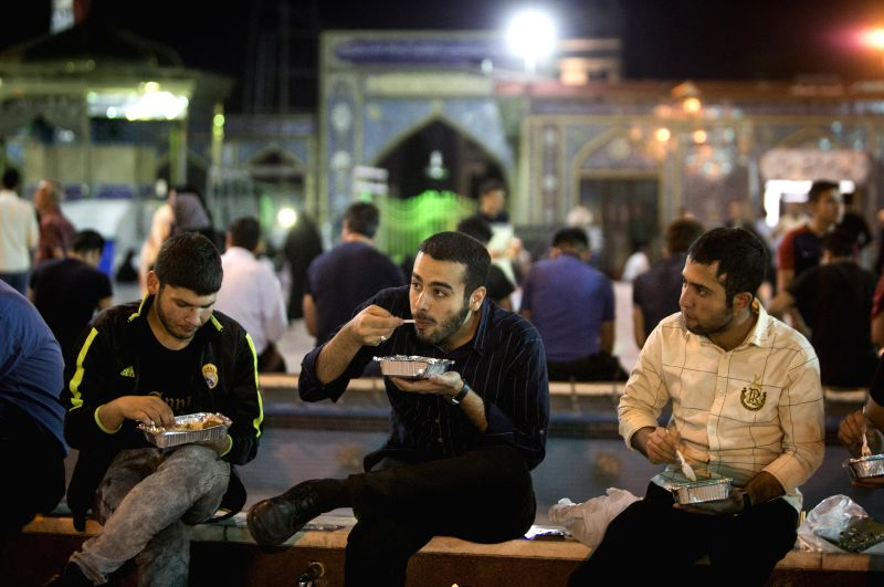 TEHRAN, June 10, 2018 - Iranian Muslims eat charity food during the holy month of Ramadan at a mosque in Tehran, capital of Iran, on June 9, 2018.