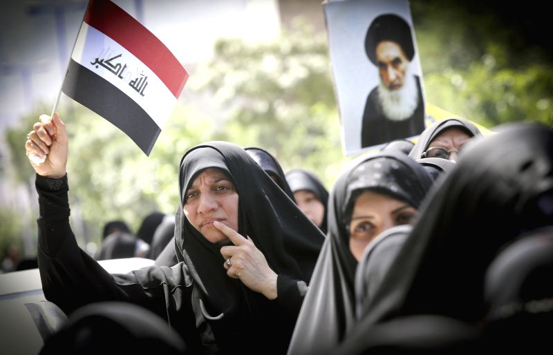 Iraqi people living in Iran take part in a demonstration against attacks carried out by the Islamic State of Iraq and the Levant (ISIL), in southern Tehran, Iran, on