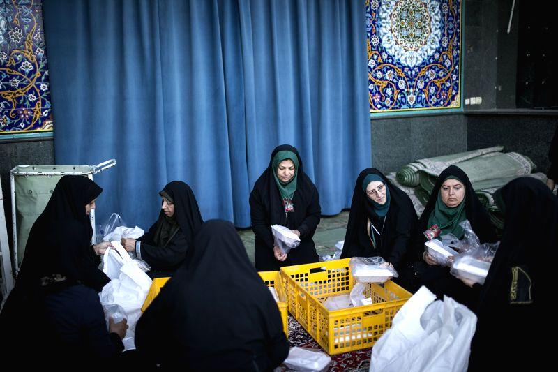 TEHRAN, June 23, 2017 - Iranian women prepare the Ramadan eid al-fitr meal to distribute to muslims during the holy month of Ramadan in Tehran, Iran, on June 22, 2017.