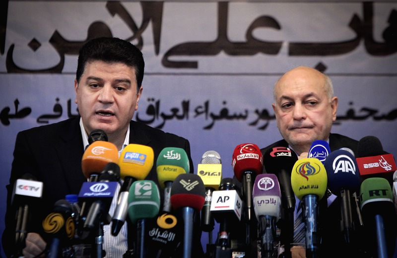 Iraqi ambassador to Iran Majid al-Sheikh (R) and Syrian ambassador to Iran Adnan Mahmud attend a joint press conference in Tehran, Iran, on June 24, 2014. Iraqi and .