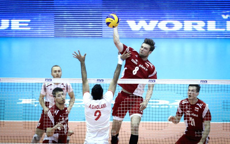 Andrzej Worna (Top) of Poland spikes the ball during the match against Iran at FIVB Men's Volleyball World League 2014 at Azadi Stadium in Tehran, Iran, on June 27, .