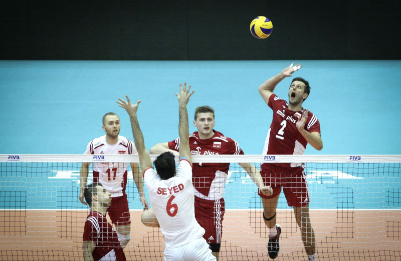 Michal Winiarski (1st, R) of Poland spikes the ball during the match against Iran at FIVB Men's Volleyball World League 2014 at Azadi Stadium in Tehran, Iran, on ...