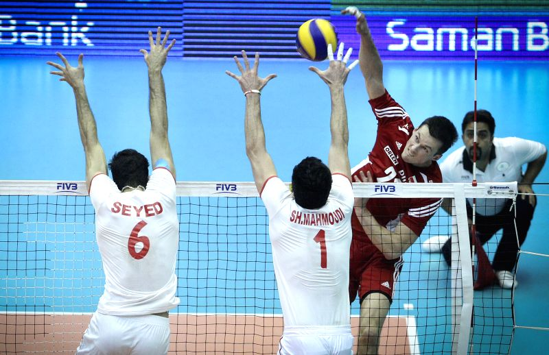 Rafal  Buszek (2nd, R) of Poland spikes the ball during the match against Iran at FIVB Men's Volleyball World League 2014 at Azadi Stadium in Tehran, Iran, on June ..