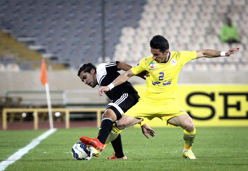 Mehdi Shiri (R) of Iran's Naft Tehran FC vies with Ahmed Ateef of Saudi Arabia's Al Shabab during their AFC Champions League Group B football match at Azadi Stadium ...