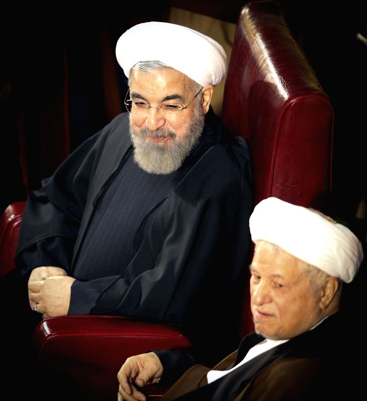 Iranian President Hassan Rouhani (L) and Former President Akbar Hashemi-Rafsanjani attend a two-day official meeting of Iran's Assembly of Experts in Tehran, Iran, ... - Hassan Rouhani