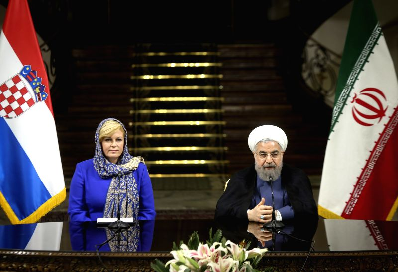 TEHRAN, May 18, 2016 - Iranian President Hassan Rouhani(R) and Croatian President Kolinda Grabar-Kitarovic attend a joint press conference at Saadabad Palace in Tehran, Iran, on May 18, 2016. Iran ... - Hassan Rouhani