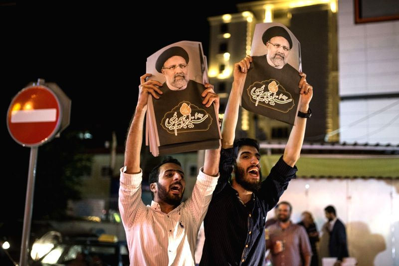 TEHRAN, May 18, 2017 - Supporters hold posters of presidential candidate Ebrahim Raisi during a street campaign in Tehran, Iran, May 18, 2017. Iran's 12th presidential election is scheduled for May ...