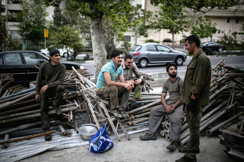TEHRAN, May 2, 2017 - Laborers rest after work at a construction site on the International Workers' Day in Tehran, capital of Iran, on May 1, 2017. (Xinhua/Ahmad Halabisaz)