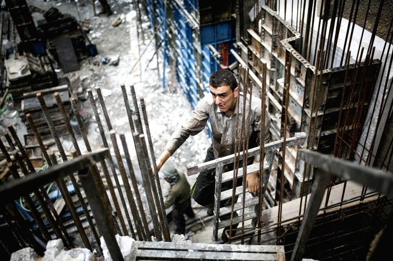 TEHRAN, May 2, 2017 - Laborers work at a construction site on the International Workers' Day in Tehran, capital of Iran, on May 1, 2017. (Xinhua/Ahmad Halabisaz)