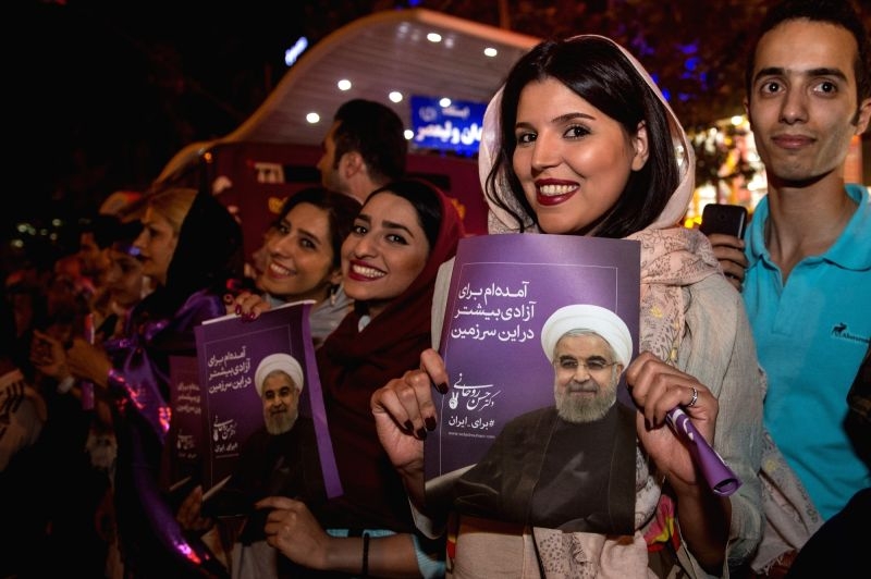 TEHRAN, May 21, 2017 - Supporters of Iranian President Hassan Rouhani celebrate victory in Tehran, Iran, May 20, 2017. Iran's incumbent moderate President Hassan Rouhani won the presidential election ... - Hassan Rouhani