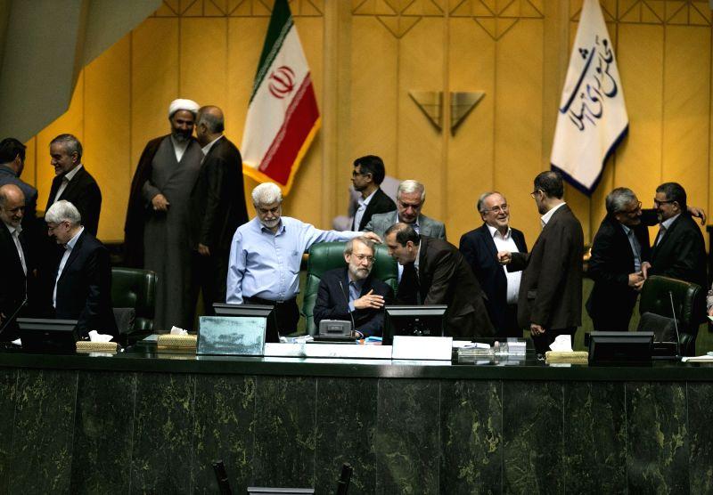 TEHRAN, May 31, 2017 - Iran's re-elected Parliament Speaker Ali Larijani (C) talks with lawmakers at Iranian Majlis (parliament) in Tehran, Iran, on May 31, 2017. Iranian Majlis (parliament) on ... - Ali Larijani