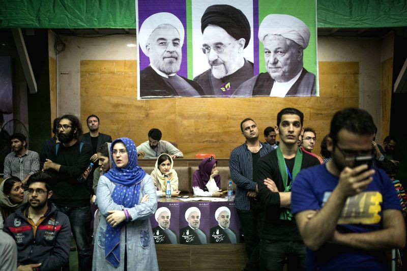 TEHRAN, May 4, 2017 - Supporters of Iranian incumbent President Hassan Rouhani, who is also the President candidate, attend a campaign rally in Tehran, Iran, on May 4, 2017. Iran's presidential ... - Hassan Rouhani