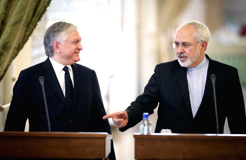 Iranian Foreign Minister Mohammad-Javad Zarif (R) and his Armenian counterpart Eduard Nalbandyan hold a joint press conference in Tehran, capital of Iran, on May 5, ...