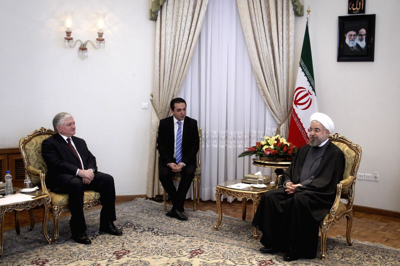 Iranian President Hassan Rouhani (R) meets with visiting Armenian Foreign Minister Eduard Nalbandyan (L) at Presidential Palace in Tehran, capital of Iran, on May 5, ..