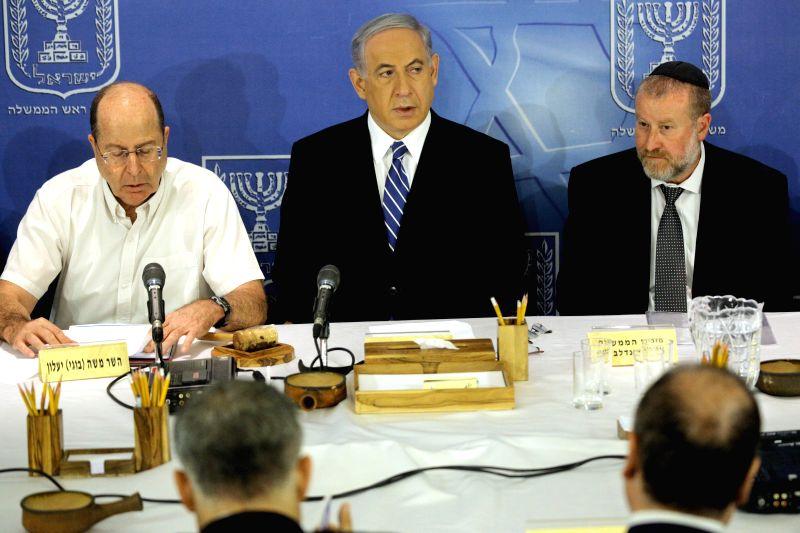 Israeli Prime Minister Benjamin Netanyahu (C) speaks during the weekly cabinet meeting at the Defense Ministry in Tel Aviv Aug. 24, 2014. Benjamin Netanyahu said ..