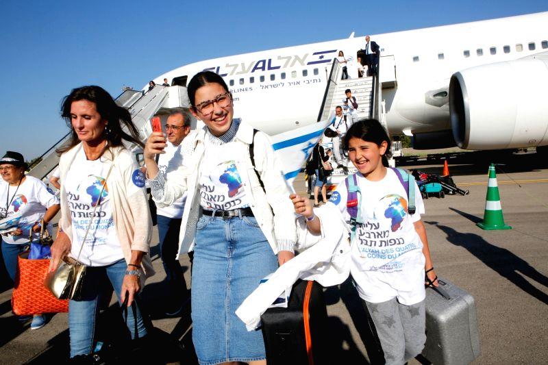 TEL AVIV, July 23, 2018 - Jewish new immigrants walk down a plane after landing at Ben Gurion International Airport near Tel Aviv, Israel, on July 23, 2018. Some 300 new Jewish immigrants arrived in ...