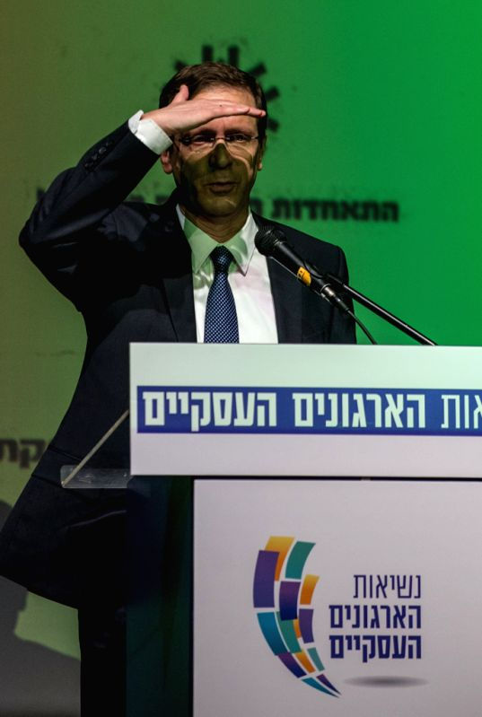 Israel's Zionist Union leader Isaac Herzog, also chairman of the Labor Party, gestures during the Presidium of the 2015 election business organizations at the Dan ... - Tzipi Livni