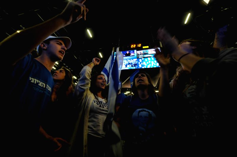 Supporters cheer up after the exit polls' results come out at the Zionist Union campaign headquarters in Tel Aviv, Israel, on March 17, 2015.  Israeli Prime ... - Benjamin Netanyah