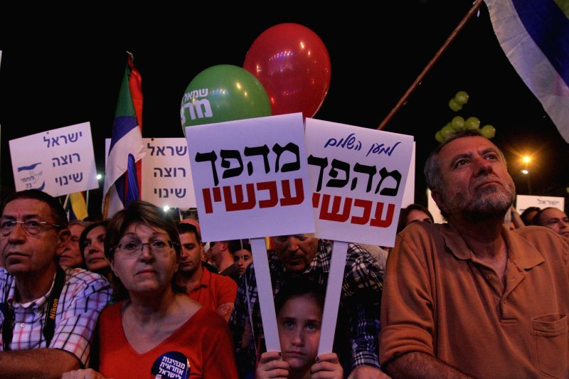 Israelis take part in a rally on the Rabin Square in Tel Aviv, Israel, on March 7, 2015. Tens of thousands of protesters rallied at a square in central Tel Aviv on ... - Benjamin Netanyahu