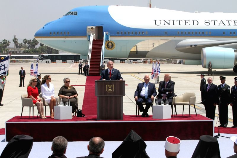 TEL AVIV, May 22, 2017 - Israeli Prime Minister Benjamin Netanyahu (C) delivers a speech at the welcome ceremony for U.S. President Donald Trump (On stage 1st R) at Ben Gurion International Airport ... - Benjamin Netanyahu