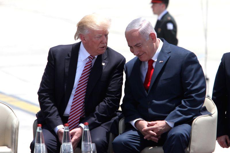 TEL AVIV, May 22, 2017 - U.S. President Donald Trump (L) speaks with Israeli Prime Minister Benjamin Netanyahu at Ben Gurion International Airport in Tel Aviv, Israel, on May 22, 2017. Trump has ... - Benjamin Netanyahu