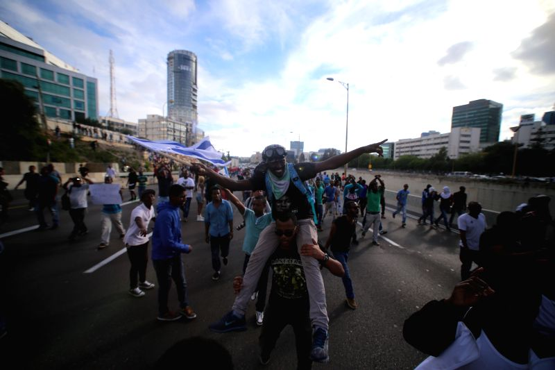 Israeli Ethiopian protesters clash with Israeli police during an anti-racism rally in Tel Aviv, Israel, on May 3, 2015. Thousands of Israeli Ethiopians and their ...