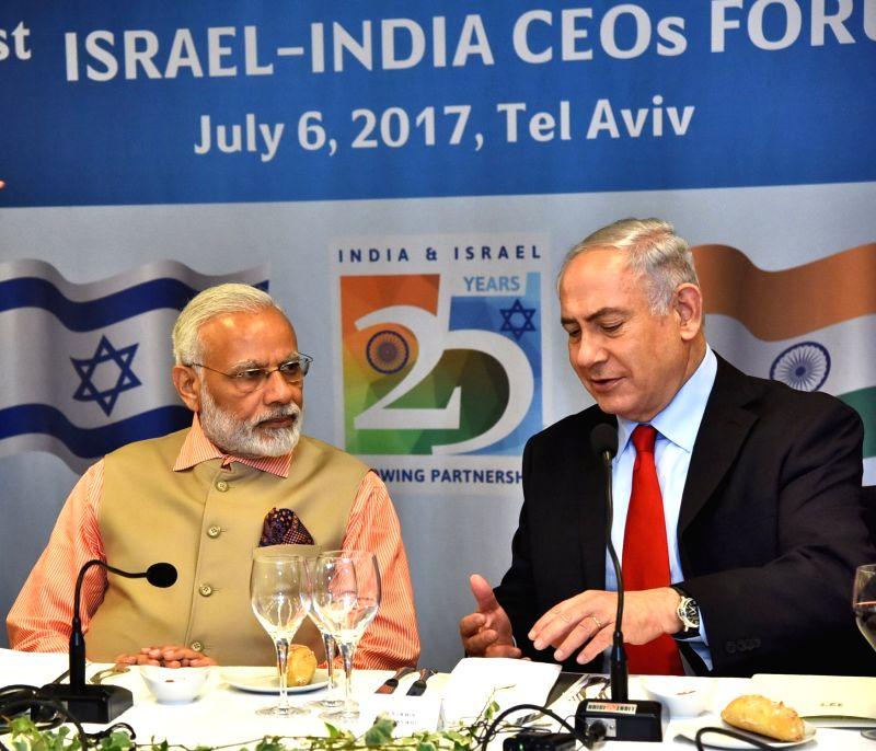 Tel Aviv: Prime Minister Narendra Modi and Israeli Prime Minister Benjamin Netanyahu at the 1st India - Israel CEOs Forum in Tel Aviv, Israel on July 6, 2017.