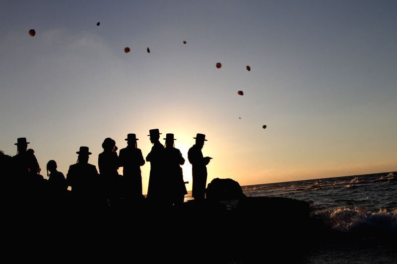 TEL AVIV, Sept. 28, 2017 - Ultra-Orthodox Jews perform the Tashlich ritual on the shore of the Mediterranean Sea in Palmachim near Tel Aviv, Israel, on Sept. 28, 2017. Tashlich is a ritual during ...