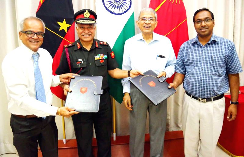 Telangana and Andhra Sub Area General Officer Commanding Major General N Srinivas Rao, Hyderabad BITS-PILANI Director G Sunder witnesses the MoU exchange ceremony between Army College of ...
