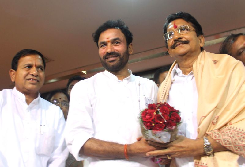 Telangana BJP chief G Kishan Reddy felicitates Maharashtra Governor designate Chennamaneni Vidyasagar Rao during a programme in Hyderabad on Aug 26, 2014. - G Kishan Reddy