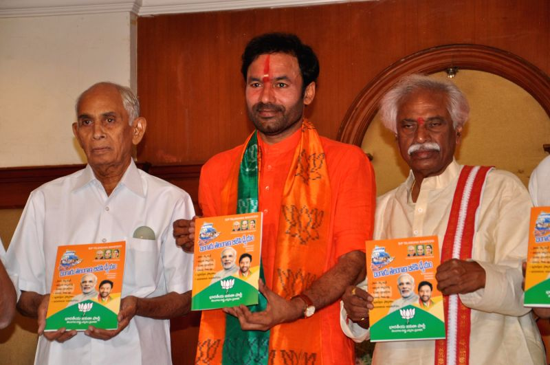 Telangana BJP president G Kishan Reddy, senior leader of the party Bandaru Datatiriya and other party leaders release party's manifesto in Hyderabad on April 18, 2014. - G Kishan Reddy