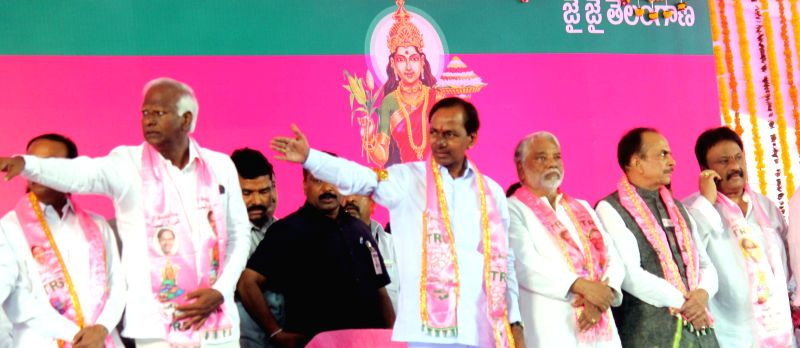 Telangana Chief Minister and Telangana Rashtra Samithi (TRS) chief K Chandrasekhar Rao, TRS Secretary General K Keshav Rao and others at TRS plenary in Hyderabad, on April 24, 2015. - K Chandrasekhar Rao