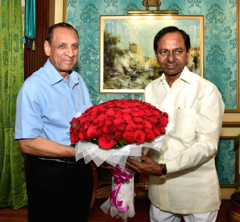 Telangana Chief Minister K. Chandra Shekar Rao meets the state's governor E. S. L. Narasimhan at Raj Bhavan, in Hyderabad on July 22, 2018. - K. Chandra Shekar Rao