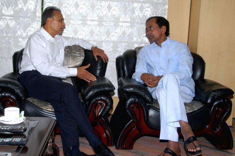 Telangana Chief Minister K Chandrasekhar Rao during a meeting with Reliance ADA Group Chairman Anil Ambani in Hyderabad on July 7, 2014. - K Chandrasekhar Rao