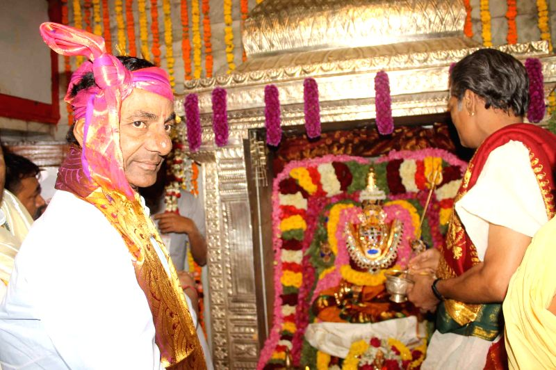 Telangana Chief Minister K Chandrasekhar Rao offers prayers at a temple during Bonalu in Hyderabad on July 20, 2014. - K Chandrasekhar Rao