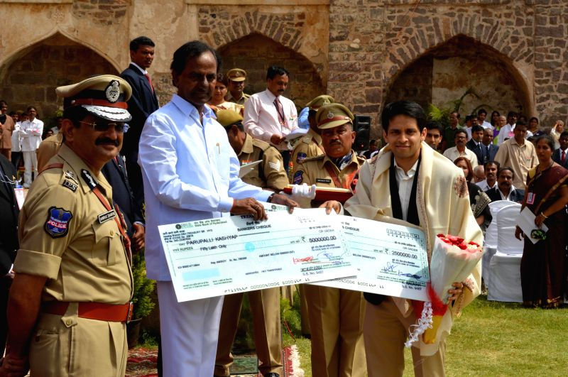 Telangana Chief Minister K Chandrasekhar Rao presents a cheque to Indian badminton player Parupalli Kashyap during 68th Independence Day celebrations at Golkonda Fort, some 11 km away from Hyderabad . - K Chandrasekhar Rao and Parupalli Kashyap